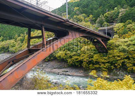 Iron railway bridge over Hozu River in Arashiyama Japan