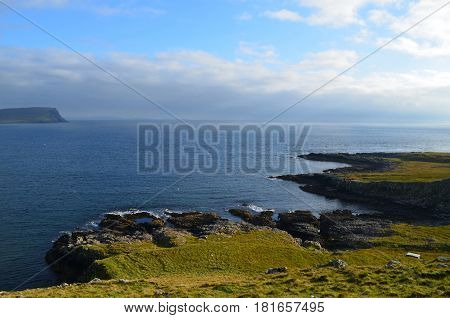 Beautiful rugged rocky coastline on Neist Point in Scotland.