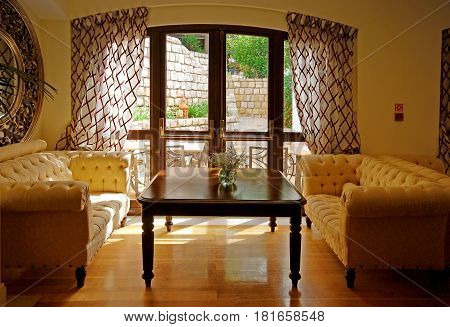 ALGARVE, PORTUGAL - OCTOBER 5, 2009: cozy interior with classical furniture mirror and window in resort hotel lobby Algarve Portugal