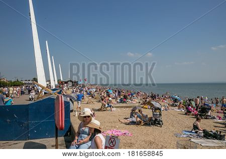 SOUTHEND ESSEX ENGLAND - 20th July 2016: Crowded beach at Southend on Sea on a boiling hot summer day in July.