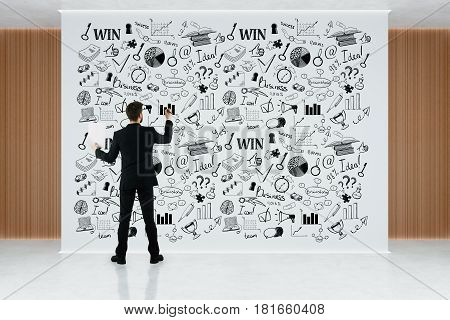 Back view of young businessman in interior drawing sketch on billboard. Success concept. 3D Rendering