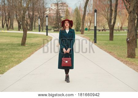 Beautiful Blond Woman in Hat. Fashionable Lady in Topcoat. Elegance Beauty. Spring Collection Shopping