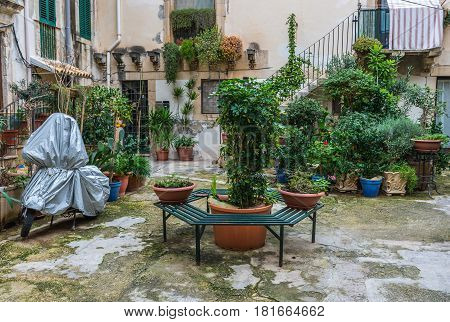 Small town house courtyard on Ortygia isle Syracuse city Sicily Island in Italy