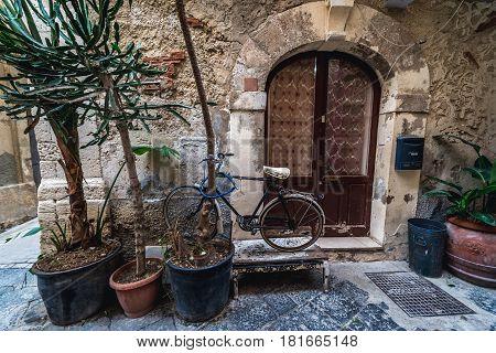 Building entrance on Ortygia isle Syracuse city Sicily Island in Italy