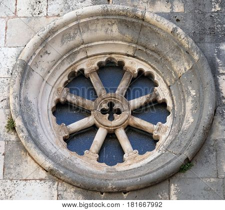 KORCULA, CROATIA - NOVEMBER 09: Rose window on the St Michaels church, in the old town of Korcula, Dalmatia, Croatia on November 09, 2016.