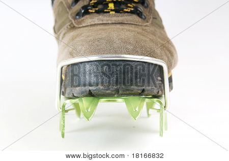 Brand new crampon on boot closeup