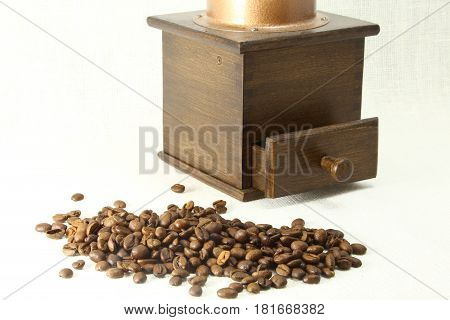 coffee grinder and coffee bean on white background