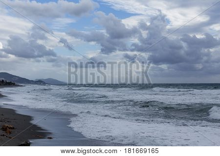 powerful waves heating cost of mediterranean Turkey in Alanya with mountains on background shot on cloudy day