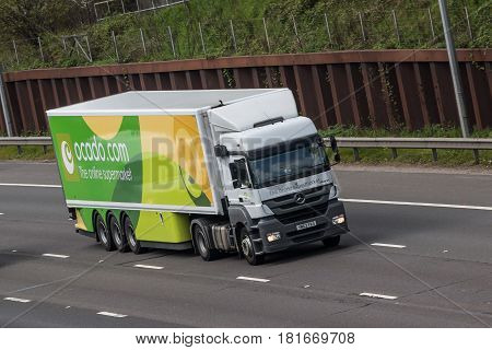 London UK - March 05 2017: Lorry belonging to the British online supermarket Ocado.com in motion on M25 motorway