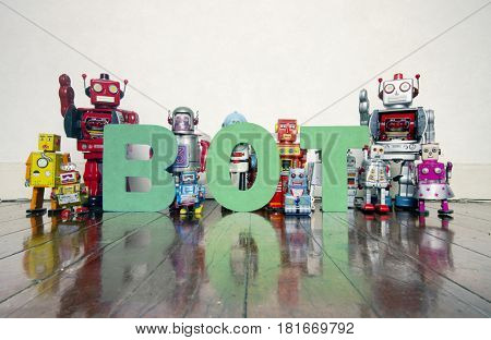 the word BOT with vitage robot toys