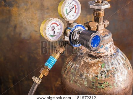Reducer with pressure gages on the oxygen tank By attaching a devive to prevent the fire back into the tank.Flashback arrestor for regulator The safety equipment in the workplace.