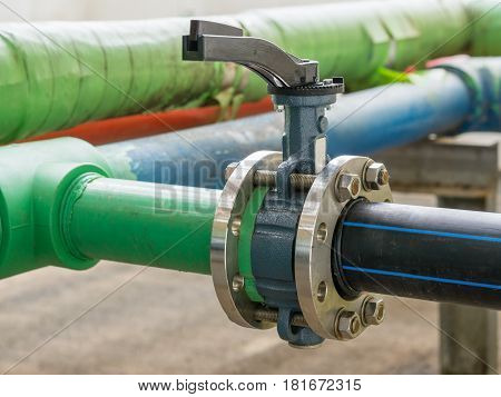 Butterfly valve at the connection hdpe pipe and pp-r pipe.manual valveselective focus.
