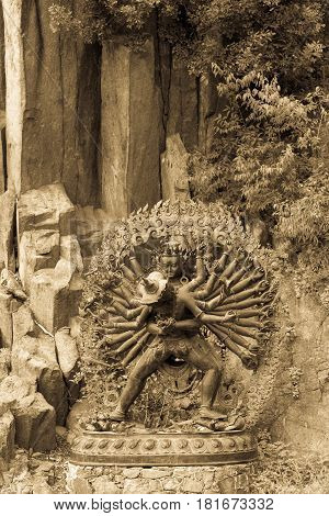 Tantric Deities Statue In Ritual Embrace Located In A Mountain Garden