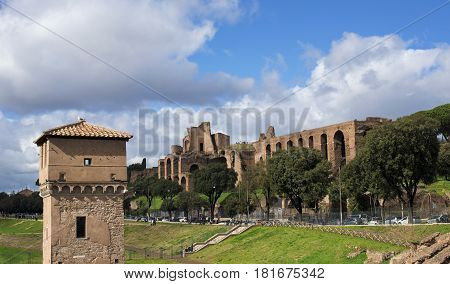 ROME, ITALY - MARCH 5: Ancient ruins of Palatine Hill Imperial Palace viewed from Circus Maximus in the city center with tourists  MARCH 5, 2017 in Rome, Italy