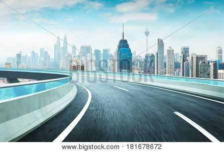 Highway overpass motion blur effect with modern city skyline background . Day time scene .