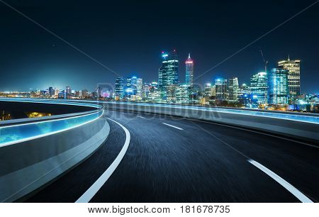 Highway overpass modern city skyline background . Night scene .