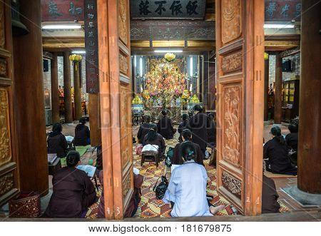 Hanoi Vietnam - Feb 20 2017 : Vietnamese monks praying at Chua Ba Da temple in Hanoi Vietnam