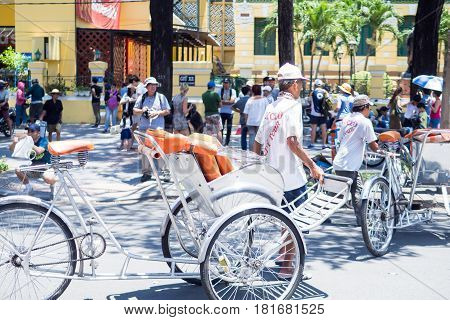 SAIGON, VIETNAM - MARCH 26, 2017: : Bicycle rickshaw taxi in Ho Chi minh city downtown cheap cost near the famous place.