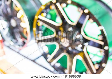 Abstract blurred alloy wheels car in store