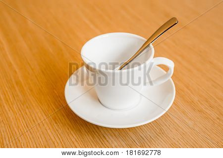 a cup of coffee on a wooden table