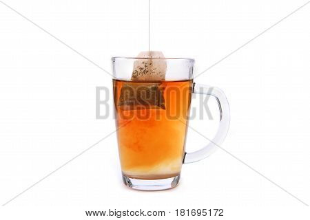 Tea glass cup with tea bag. Tea cup isolated on white background.