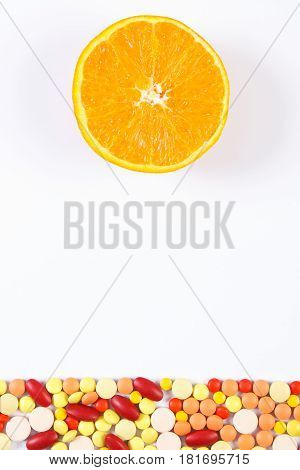 Colorful Medical Pills And Fresh Orange On White Background, Health Care And Healthy Lifestyle Conce