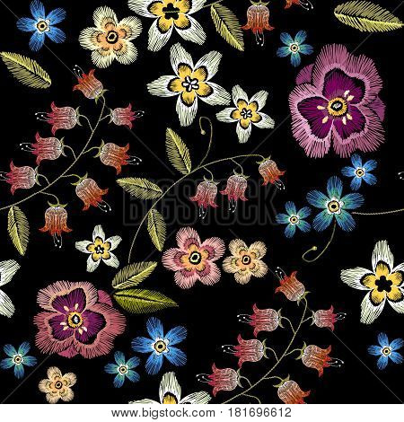 Embroidery flowers seamless pattern. Fashionable template for design of clothes. Beautiful camomiles cornflowers classical embroidery seamless background