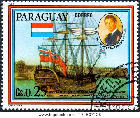 UKRAINE - CIRCA 2017: A postage stamp printed in Paraguai shows sailing ship HMS Culloden and portrait of Prince Charles from the series Wedding of Prince Charles and Lady Diana Spencer circa 1981