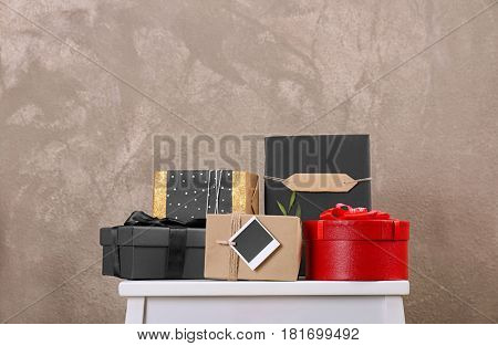 Stylish present boxes on textured wall background