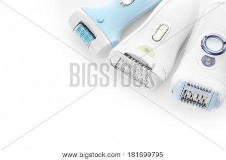 Modern epilators on white background