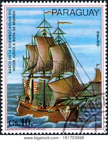 UKRAINE - CIRCA 2017: A postage stamp printed in Paraguai shows sailing ship boat at the mouth of the Weser near Bremen buoy from the series Paintings German ships circa 1977