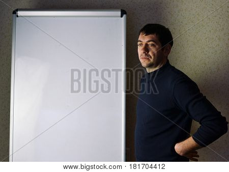 Executive man writing on a flipchart business presentation