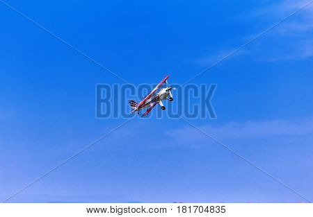 A sport turboprop aircraft in flight against the blue sky.
