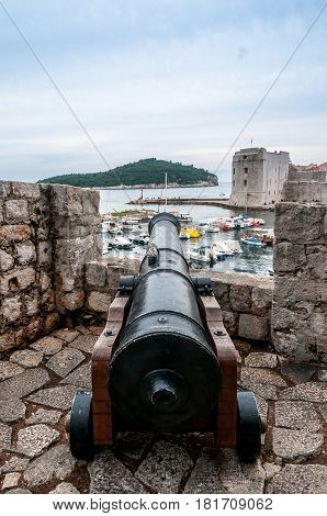 Dangerous cannon pointing out at Lokrum island from Dubrovnik city wall.