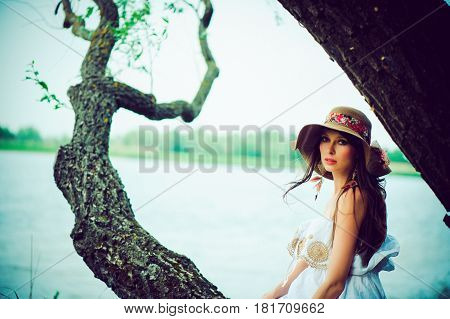 Pregnant Woman Sitting On Tree