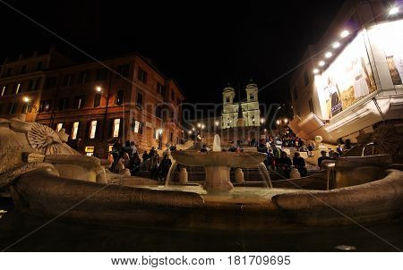 ROME ITALY - APRIL 4 2017: Spanish Steps crowded with the locals and tourists at night Barcaccia Fountain in the foreground