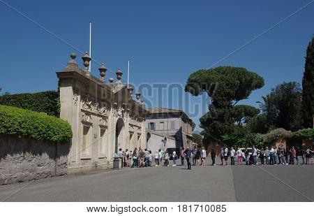 ROME ITALY - APRIL 9 2017: Tourist line waiting to look through the keyhole of the Villa Magistrale dei Cavalieri di Malta in Cavalieri di Malta square