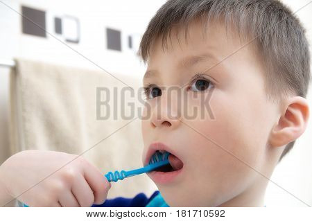 Boy brushing teeth child dental care oral hygiene concept child in bathroom with tooth brushhealthy lifestyle
