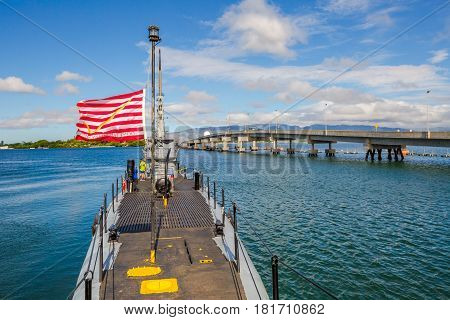 HONOLULU, OAHU, HAWAII, USA - AUGUST 21, 2016: USS Bowfin Submarine SS-287 with American First Navy Jack flags at Pearl Harbor Honolulu Hawaii, United States. Open to public tours inside and outside.