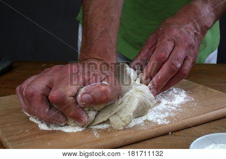 ZAGREB, CROATIA - SEPTEMBER 21: Baker preparing some dough ready to bake some bread, Zagreb, Croatia on September 21, 2016.