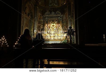 ROME ITALY - APRIL 13 2017: The Forty Hours Devotion Machine for centuries 213 candles have lit up the church of Santa Maria dell Orto in Trastevere during the Maundy Thursday
