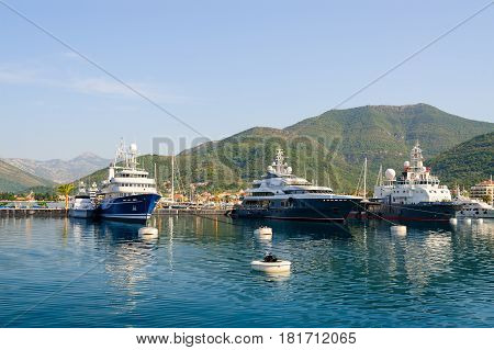 TIVAT MONTENEGRO - SEPTEMBER 16 2015: Ships in Tivat Bay on background of mountains Montenegro