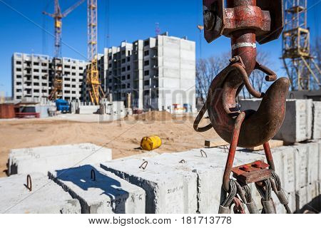Hook of the construction crane for lifting more cargo at the construction site