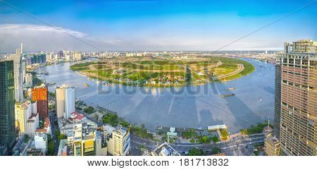 Ho Chi Minh City, Vietnam - April 11, 2017:Panorama High view Saigon skyline when the sun shines down urban with tall buildings along river showing development of country in Ho Chi Minh City, Vietnam