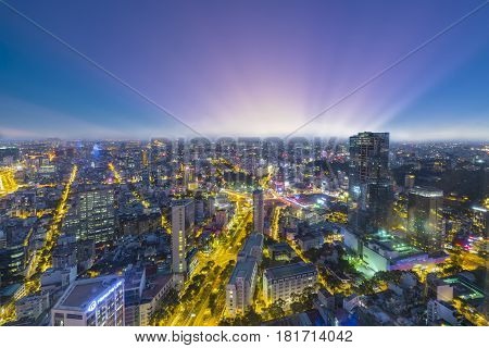 Ho Chi Minh City, Vietnam - April 11, 2017: High view Saigon skyline when sunset urban areas colorful and vibrant cityscape of downtown with traffic light trails by night in Ho Chi Minh city, Vietnam