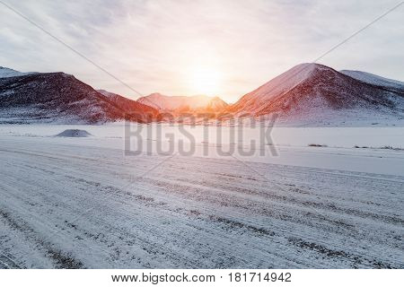 empty road and sunlight with snow covered landscape on tibet plateau