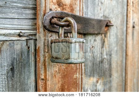 lock and forged curtain on a wooden door