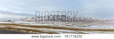 a panoramic view snow mountains on tibet plateau snow area plateau background