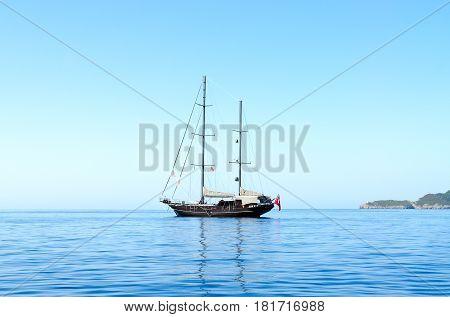 Beautiful view of yacht in sea near Budva coast Montenegro