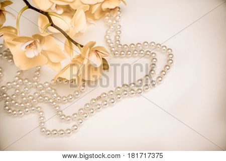 pearl and yellow Orchid on white glass